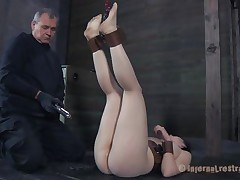 Freshly out of the box the milky white brunette with large soft boobs receives a rough mouth fucking from her executor. After warming her up with his dick the guy puts her on the floor with her legs up and inserts a speculum in her tight pussy. Like how it looks inside, some semen would make it look more good