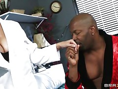 Mature busty blonde doctor arrives for checkup of her patient. Black man starts to seduce her and offers her for ride of her lifetime. At first doctor denies but not fast and steadily comes in the charm of huge hard black cock. That guy makes her stripped and takes her to the sofa and licks her fleshy pussy.
