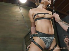 What do we have here? It's a slut, all bound up in leather belt and hangs there expecting to be punished. This babe was a very bad angel and her punishment needs to be hard! Wenona has her face hole gagged and the executor rubs her muff with a vibrator. Let's see if this man has something to stick it in her ass