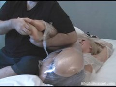 Playgirl fastened in plastic wrap giggles while tickled