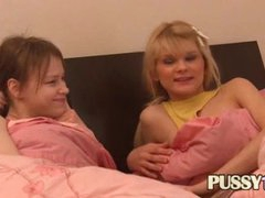 Two cuties in the bed tempt their friend