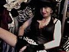 This eccentric dark-haired woman masturbates wearing an odd costume, she even wears a hat. This is one of the almost any original homemade clips though.