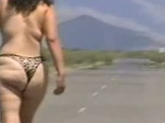 Out in the open desert walking in the middle of a highway with only a g-string covering her big wazoo body. In this public sex video u can see this aged bitch walk naked out in the open and flaunt her big fucking ass.