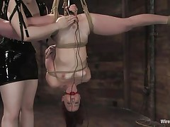 Claire Adams has Trinity Post's vagina wired. She's not merely bound up but upside down, and gagged to boot. She's got a metal plug in her snatch and Claire's using a vibrator on her clit, making her crave to cum. This babe gets permission to cum and that babe does several times, moaning loudly through her ball gag.