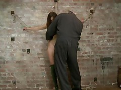 Our cute wench Casey wears a couple of high heels boots and no thing more. This babe looks fine like that and the executor is glad to chastise her hot body. He tied her on the wall, ball gagged her and used a rope to pull her body up while she was still tied on that wall. Look how much she suffers and endures for our pleasure