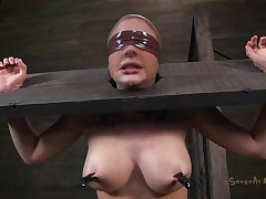 Clamps with weights were attached on her big billibongs and duct tape was used to blindfold her. Now that babe stays there in that thraldom device and has a rodeo sex machine under her that's rubbing her shaved pussy. To make things interesting an executor comes and deeply face hole fucks this wench girl, chocking her with pecker
