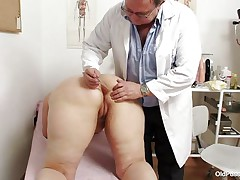 Yvonne is at gynecologist completely naked and waits for the doctor to examine her body. She's a bit overweight but that means there's a lot more to love as the doctor carefully and gently inserts a medical tool in her hot bald darksome hole and then this chab gapes her bald vagina looking inside her pink pussy, that cunt is consummate for a hard dick and maybe the doc will give her some fucking therapy.