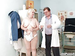 Bozena is a older lady with big boobs, horny face and big ass. After doctor asks her to strip this chap is using a engulfing machine to make her nipples harder. This doc has a messy mind and surely this chap is making her horny, who knows what tricks this chap has to make this old wench ready to fuck.