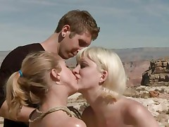 They are in the desert, the burning sun is upon 'em and made 'em insanely hot so they fuck like crazy, one chick licks the other ones fur pie and gets drilled in the rectal hole with a dildo. The blonde that is receiving a tongue in her fur pie is tied and lays on the sand, will the guy cool her with some sperm?