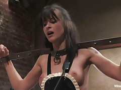 Cecilia Vega has a very hard to please boss in Princess Donna Dolore! Cecilia's hands are bound, this babe has large beads in her pussy attached to wires, and is getting her little titties whipped! They're as red as Princess Donna's dress! After some more whipping, this babe tells Cecilia to dust some more.