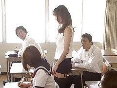 Manami Suzuki can't live without teaching. Someone's out to expose her for the bitch that babe really is, hitting the remote control of her vibrator, causing her to moan as that babe walks throughout the class. A student's father comes in, his son saying the teacher's a porn star. Pretty soon she's nude in front of the class.