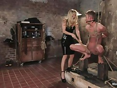 That babe got her guy tied nice-looking good and now she's having some pleasure with his body, paying a lot of particular attention to his cock. This sexy bossy milf with blonde hair and fit body is using her tools to taunt and induce pain to her man. Look at her spanking his 10-Pounder and body as he's tied up and ball gagged.