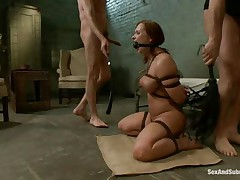 This brown hot floozy is a prisoner of this two guys. This hottie is naked and bounded and this hottie sits on the floor and waits to be punished by these guys with big cocks. One of 'em copulates her throat and after that this guy penetrates her soaked vagina. The slut screams of joy and this hottie is ready for a threesome.