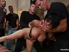 Eva Angelina is a white 27 years old american girl with a nice pair of mangos which has the bad luck to be surrounded by five horny guys who like coarse fucking. They test her mouth size by inserting their dicks so deep until she can't even breathe. Next, they widen her legs and alternative fuck her