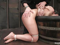 The old, experienced executor is showing this youthful hotty what this guy is capable of. He tied her hands and legs and grabbed her by the neck so this guy could put her head below water. That honey is wet and dominated and looks like this slut enjoys her situation a lot, especially when this guy slaps her ass and uses a sex tool to stimulate her clit.