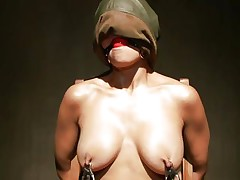 Sexy Beretta sits on a chair with her hands fastened up and is face hole gagged. With her nipples tortured, her executor moves to her miniature cunt and puts a pump on it to suck it all in. The doxy moans with pleasure, while he sticks a dildo on her juicy cunt and grabs her nipples a little. This is so hot!