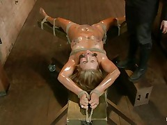 Blond slut Cameron is all tied up with strings to a wooden table and face hole gagged. With her legs spread, that babe receives fingered and has a sex tool on her clitoris. Let`s take a close look at that hot oiled up body and with wax all over her! Will her dominant-bitch make that wench cum if her cunt receives fisted so hard?