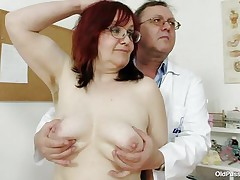 Brunette mature lady is lying on the gynecologist's table and the doctor is examining her pussy. This guy is wearing gloves and fingering her cookie right after that guy examines her nice miniature tits. This guy is inserting a thin medical tool in her tight ass. You really needs to see where the doctor ends up.