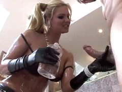 An oiled up Phoenix Marie sucks big pecker