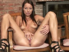 Kari rubs her shaved love tunnel by the fireplace